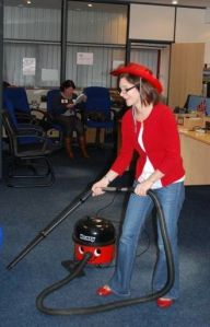 Sarah and friend clean up the office